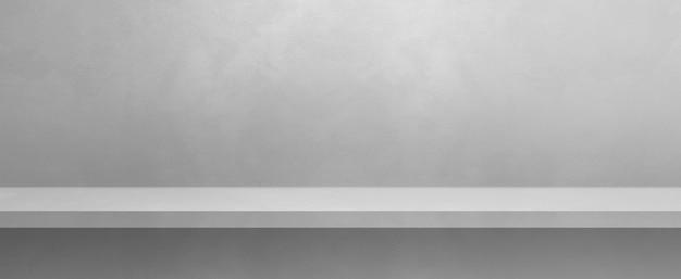 Scaffale vuoto su un muro bianco. scena del modello di sfondo. banner orizzontale