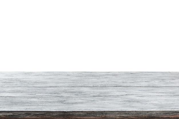 Superficie vuota del tavolo in legno grigio chiaro - negozio di sfondo bianco centro commerciale per la visualizzazione e il montaggio dei tuoi prodotti. messa a fuoco utilizzata per creare una profondità di campo completa.