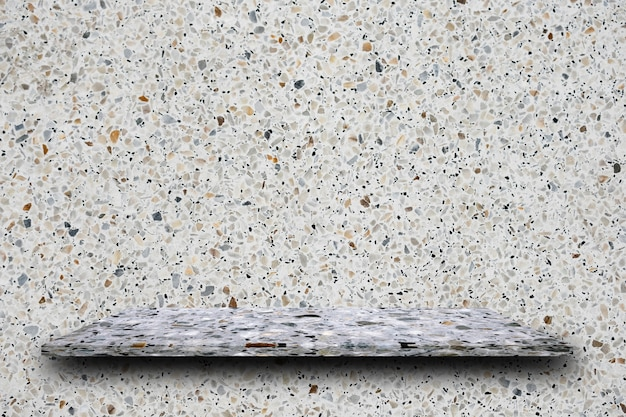 Cima vuota degli scaffali lucidati della pietra di terrazzo sul fondo di terrazzo