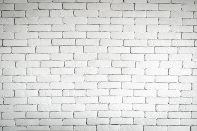 Muro di mattoni bianco vuoto per lo sfondo con copyspace