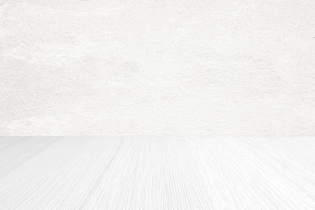Muro di cemento bianco vuoto e fondo di legno