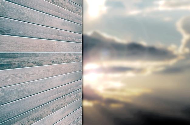 Bordo di legno vuoto sulla natura verde della sfuocatura e sullo sfondo del cielo blu