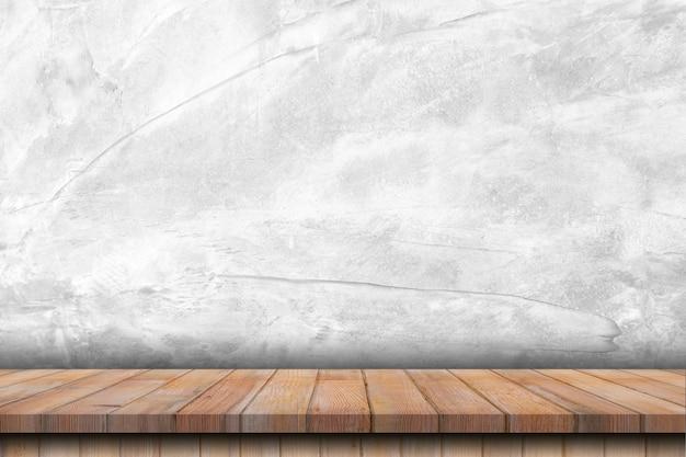 Tavolo in legno vuoto e struttura del muro di cemento e sfondo con lo spazio
