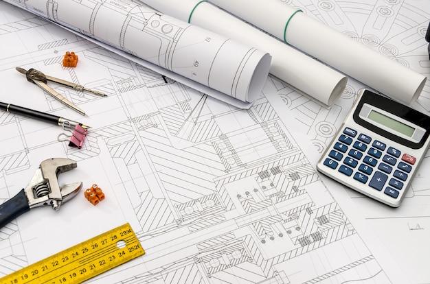 Sfondo del disegno dell'ingegnere per diversi strumenti sul tavolo