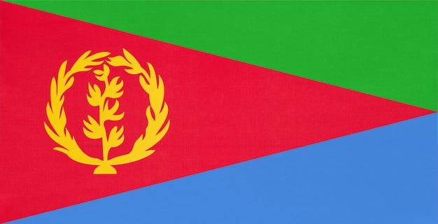 Bandiera nazionale del tessuto dell'eritrea, fondo del tessuto. simbolo del mondo paese africano.