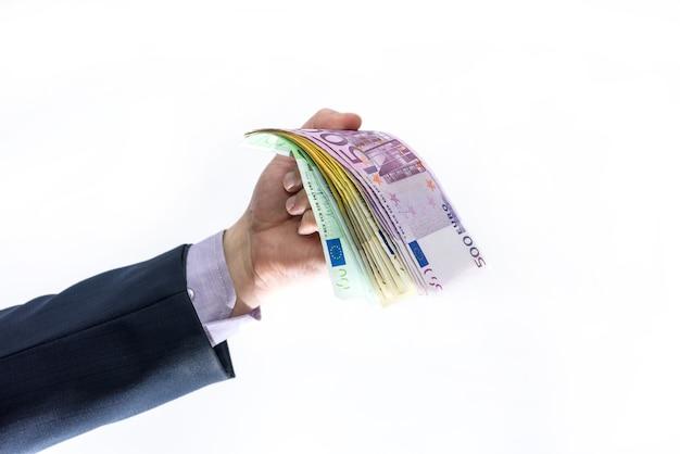 Banconote in euro a ventaglio in mano maschio
