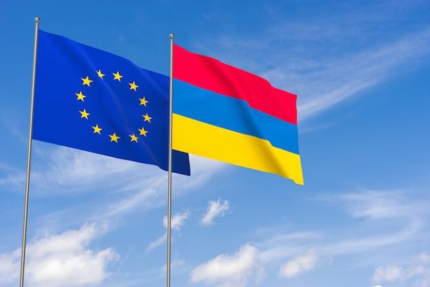 Bandiere dell'unione europea e dell'armenia su sfondo blu cielo. illustrazione 3d
