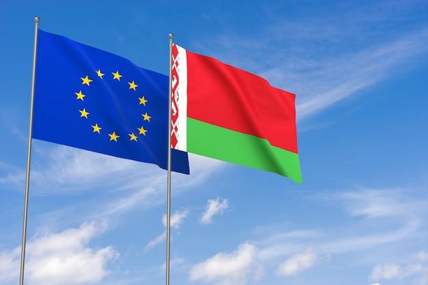 Bandiere dell'unione europea e della bielorussia sopra il fondo del cielo blu. illustrazione 3d