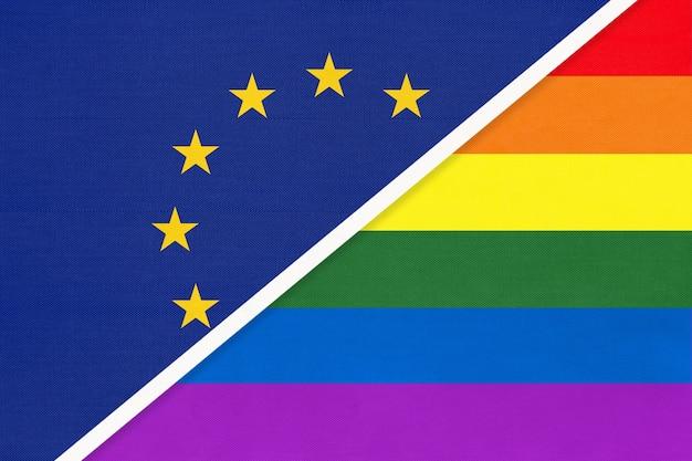 Bandiera nazionale dell'unione europea o dell'ue e bandiera arcobaleno della comunità lgbt l'una di fronte all'altra