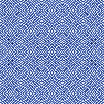 Modello senza cuciture esotico. sfondo caleidoscopio simmetrico indaco. stampa tessile pronta, tessuto per costumi da bagno, carta da parati, involucro. costumi da bagno estivi dal design esotico senza cuciture.