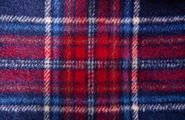 Trama plaid di lana a scacchi tessuto. sfondo di stoffa