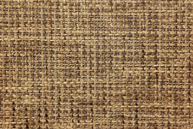 La trama del tessuto della tela da imballaggio in colori neutri si chiuda