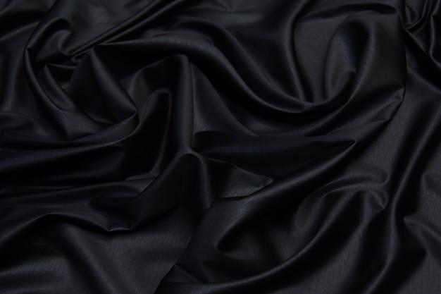 Trama del tessuto, trama del tessuto nero o modello jersey da vicino per il web design e lo sfondo della carta da parati