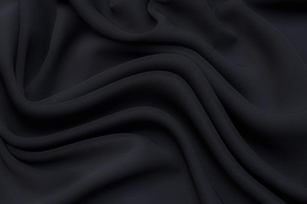 Tessuto viscosa (rayon). il colore è grigio. trama, sfondo, motivo.