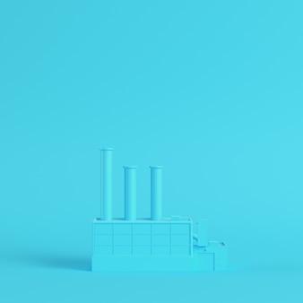 Fabbrica su sfondo blu brillante