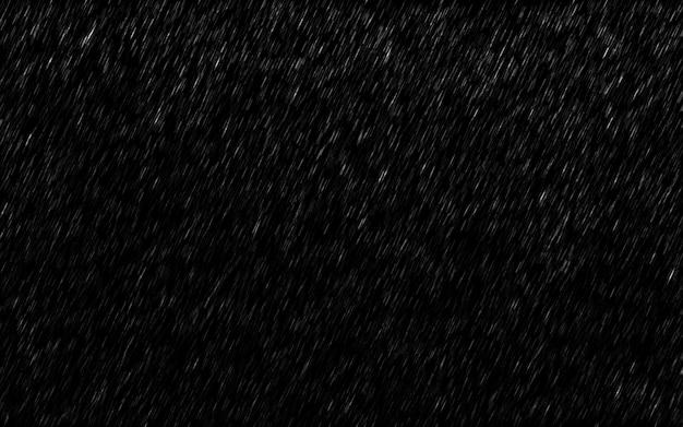 Gocce di pioggia che cadono isolato su sfondo scuro.