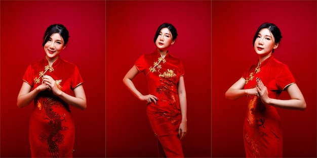 Fashion beauty woman ha lunghi capelli lisci neri che guarda la telecamera ed esprime il sentimento festeggiare. il ritratto della ragazza asiatica indossa il vestito cinese rosso sopra fondo rosso, spazio della copia