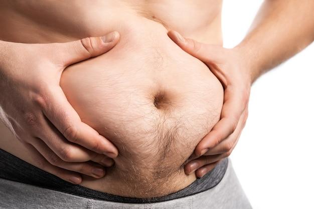 Uomo grasso con una grande pancia. dieta.