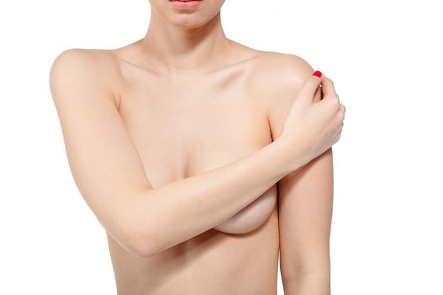 Seno di controllo femminile per cancro, isolato su bianco