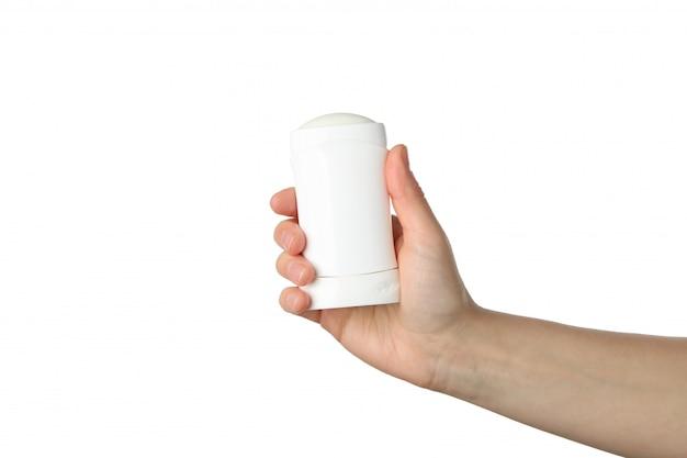 La mano femminile tiene il deodorante per il corpo, isolato su priorità bassa bianca