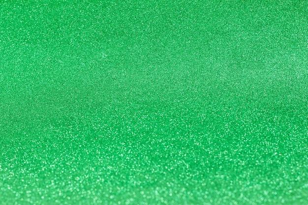 Sfocatura dello sfondo verde brillante brillante scintillio festivo, spazio della copia di san patrizio design sfocato
