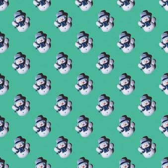 Pupazzi di neve festivi senza cuciture giocattolo su uno sfondo verde, minimalismo, disposizione quadrata, vista dall'alto. può essere usato come biglietti di natale e capodanno
