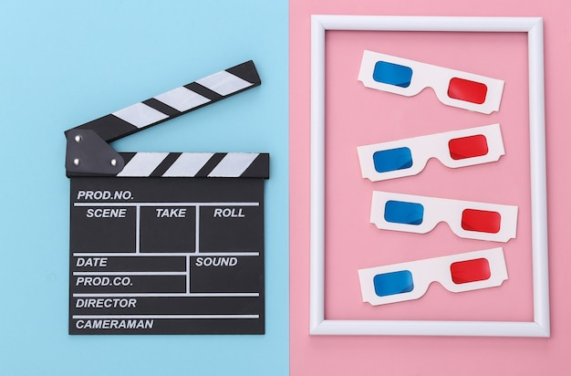 Ciak film e occhiali 3d con cornice bianca su sfondo blu rosa. industria cinematografica, spettacolo. vista dall'alto