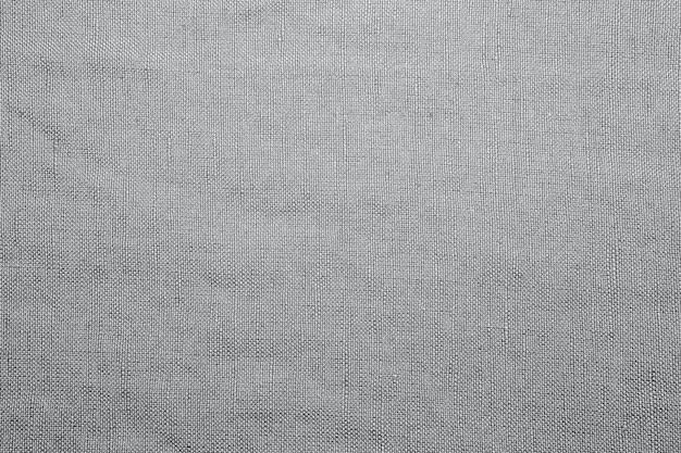 Sfondo fantasia con dettagli testurizzati in tessuto naturale di seta fine. fondo del modello di struttura della carta da parati del tessuto misto seta di cotone