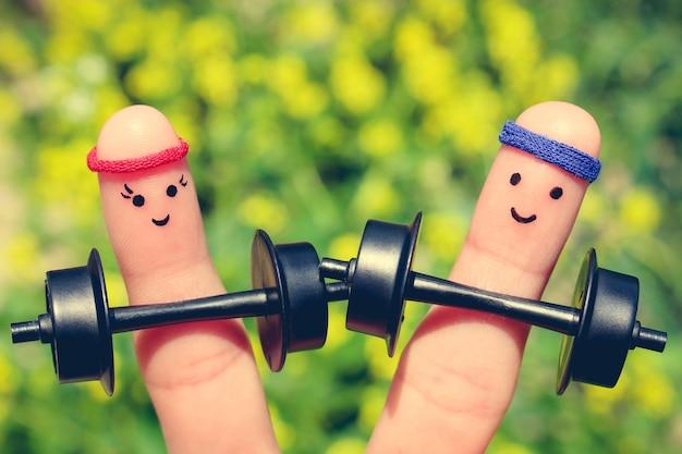 Arte del dito di una coppia felice. concetto di uomini e donne nello sport.