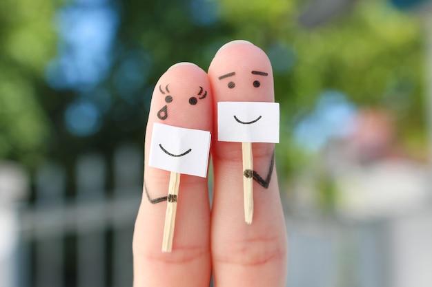 Arte delle dita di coppia. concetto di persone che nascondono emozioni.