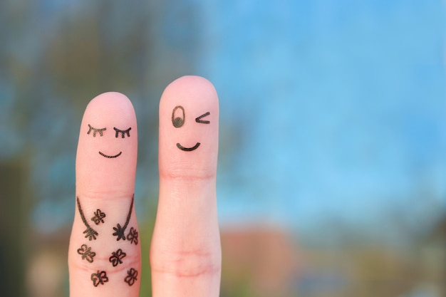Arte delle dita di coppia felice. concetto di farfalla nello stomaco.