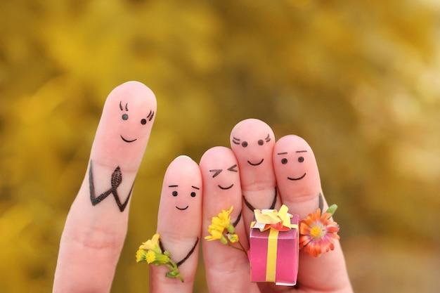 Arte delle dita di persone felici. gli scolari di concetto danno i fiori all'insegnante. festa della mamma. giornata della conoscenza. festa degli insegnanti.
