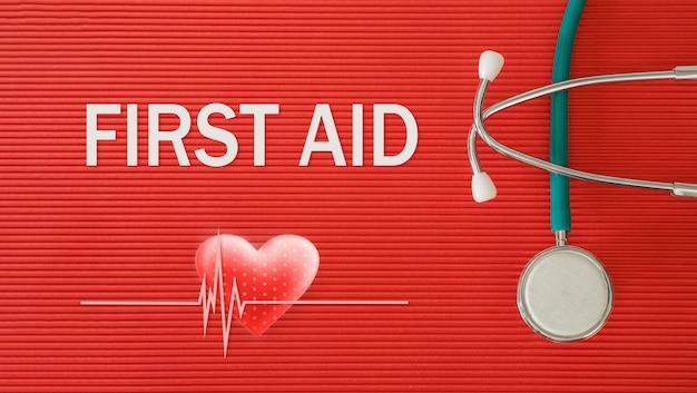 Pronto soccorso concetto con stetoscopio e forma di cuore su uno sfondo rosso