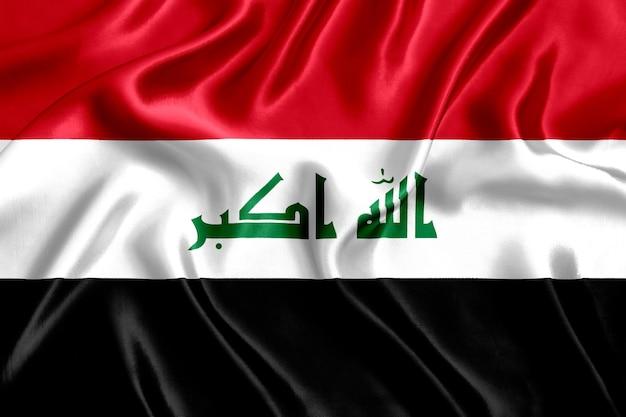 Priorità bassa del primo piano di seta della bandiera dell'iraq