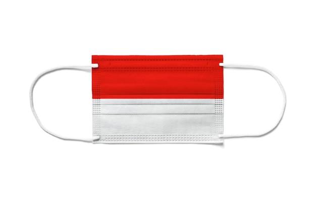 Bandiera di monaco su una mascherina chirurgica usa e getta