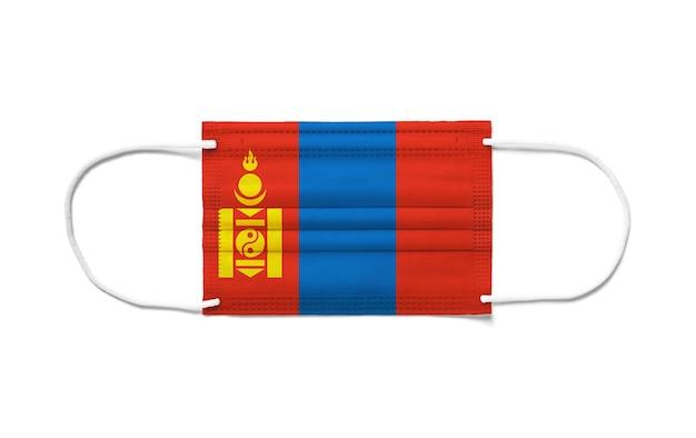 Bandiera della mongolia su una mascherina chirurgica usa e getta. sfondo bianco isolato