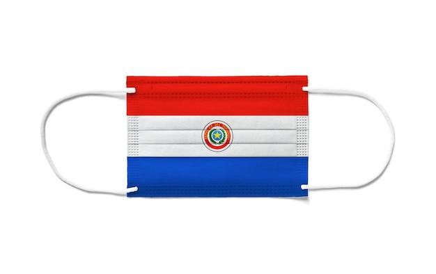 Bandiera del paraguay su una mascherina chirurgica usa e getta.