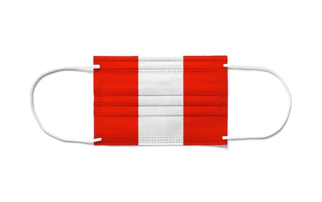 Bandiera del perù su una mascherina chirurgica usa e getta.