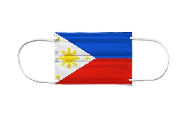Bandiera delle filippine su una mascherina chirurgica usa e getta.