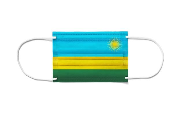 Bandiera del ruanda su una mascherina chirurgica usa e getta.