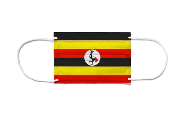 Bandiera dell'uganda su una mascherina chirurgica usa e getta