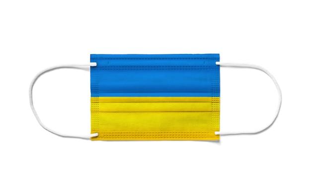 Bandiera dell'ucraina su una mascherina chirurgica usa e getta