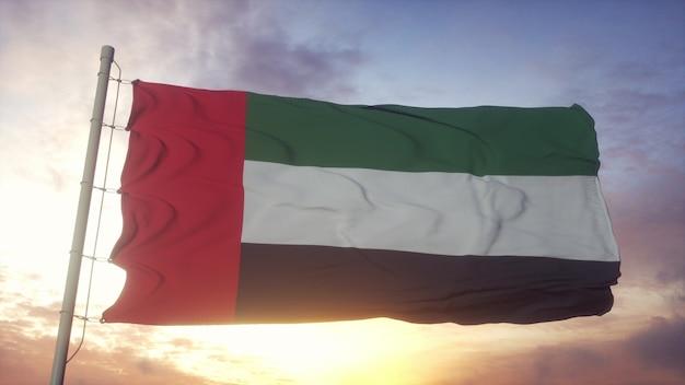 Bandiera degli emirati arabi uniti che fluttua nel vento contro il bellissimo cielo profondo al tramonto. rendering 3d.