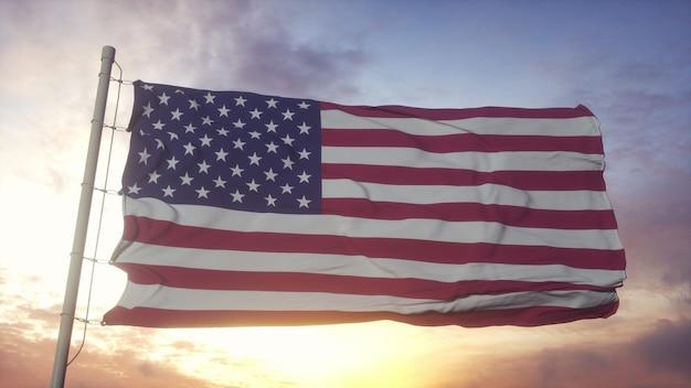 Bandiera degli stati uniti d'america che fluttua nel vento contro il bellissimo cielo profondo al tramonto. rendering 3d.
