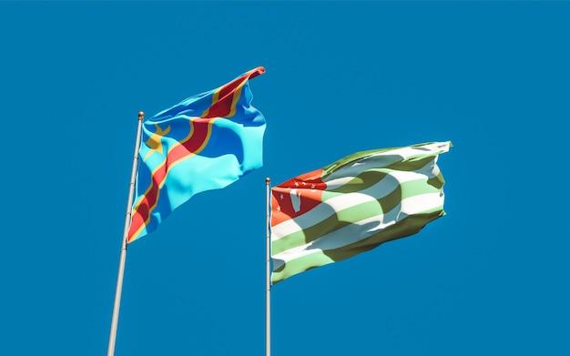 Bandiere della repubblica democratica del congo e dell'abkhazia. grafica 3d
