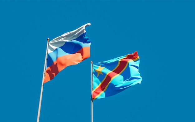 Bandiere della repubblica democratica del congo e della repubblica democratica del congo sul cielo blu. grafica 3d