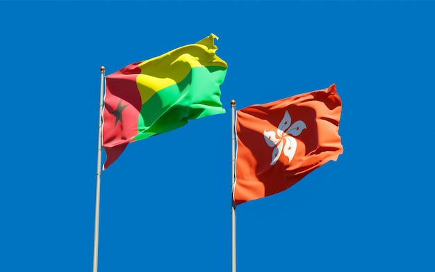 Bandiere di hong kong hk e guinea-bissau. grafica 3d