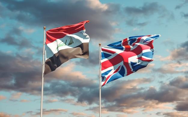 Bandiere dell'iraq e del regno unito britannico sul cielo blu. grafica 3d