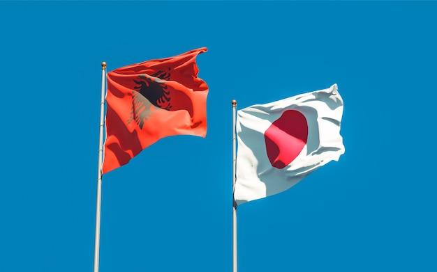 Bandiere del giappone e dell'albania. grafica 3d