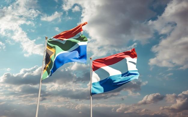 Bandiere dei paesi bassi e dell'africa sar sul cielo blu. grafica 3d